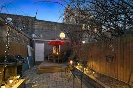 this brick townhouse with romantic backyard asks 1 495m in