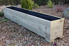 make your garden luxuries and beautiful with wooden planter boxes
