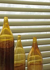 yellow glass bottles play with light yellow luxaflex home