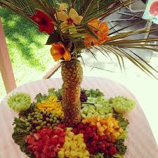 my pineapple palm tree fruit display added hibiscus flowers made