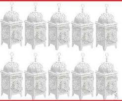 White Lantern Centerpieces by Ebluejay Weddings 10 White Scrollwork Candle Lanterns
