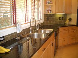 inspiring black granite countertop with window covering ideas of