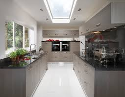 10 Beautiful Kitchens With Glass Cabinets Laconic Grey And Black Kitchen United With A Living Space Kitchen