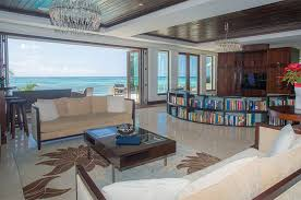 Bookshelf Behind Couch Look Inside One Of The Cayman Islands U0027 Most Exclusive Luxury Homes