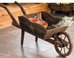 Wooden Wheelbarrow Planter by Wheelbarrow Planter Wild Wings