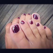 pretty pedicure purple polish with white dots on the inner corner
