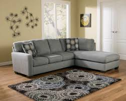 soft gray velvet couch with black cushions on the cream floor plus