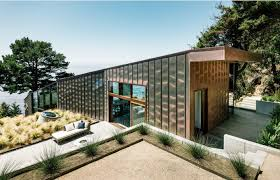 glass wall house contemporary house with glass walls and copper wall cladding