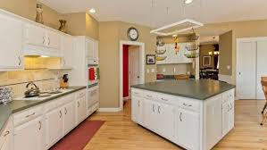 Can I Paint Over Laminate Kitchen Cabinets Should I Paint Or Refinish My Kitchen Cabinets Angie U0027s List