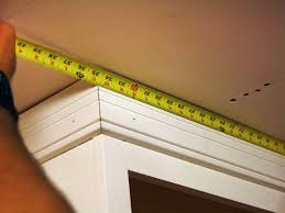 how to install crown molding on kitchen cabinets how to install kitchen cabinet crown molding how tos diy