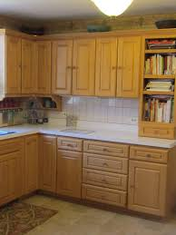 how do you clean yellowed white kitchen cabinets pics yellowing maple cabinets need help w counters