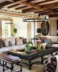 dramatic spanish home living room with antique rug also fireplace