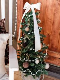 outdoor holiday decorating idea mini christmas tree hgtv
