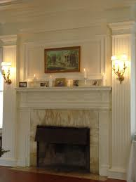 fireplace decorated with candles u0026 photos event accomplished