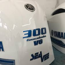 white yamaha 300 outboard with custom blue and silver graphics by