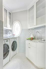 white and blue laundry room cabinets transitional laundry room