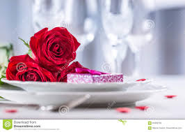 table setting for valentines or wedding day with red roses