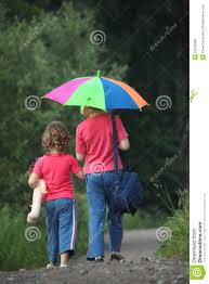 children go for walk with umbrella rear view stock photography