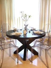 Natural Wood Dining Room Table by This Elegant Dining Room Features A Large Round Wood Dining Table