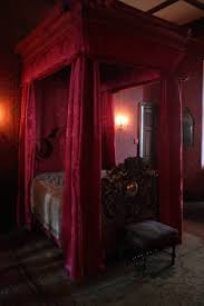 gothic bedroom decor with canopy bed and red fabric and valance