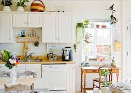 greenery above kitchen cabinets ideas with decorative plants in