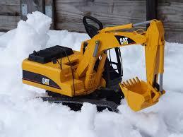 bruder excavator spiel gut in the snow the cat excavator by bruder gets its u2026 flickr