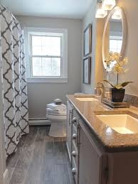 paint colors for small bathrooms rustic wooden floor with oval mirror and geometric curtain for