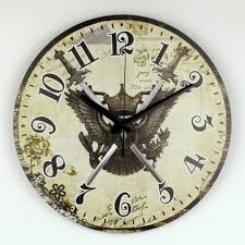 large decorative wall clocks with the symbol of an eagle at the