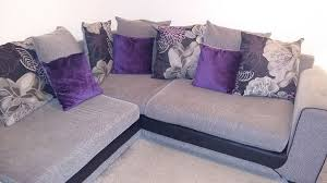 large scs grey purple and black corner sofa with foot stool