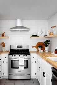 how to make cheap kitchen cabinets look better our favorite budget kitchen remodeling ideas 2 000
