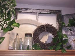 how to decorate above kitchen cupboards natural brown wooden