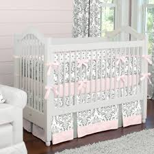 Bright Crib Bedding White Wooden Baby Crib With White Pink Pattern Bedding Set On