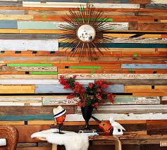 before after salvaged wood wall design sponge