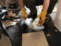 removing vinyl floor tiles with an electric steam iron
