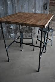 table made with pipe wood complete with sliding basket drawers