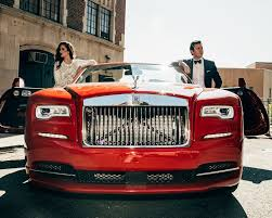 roll royce red the rolls royce dawn astute attire