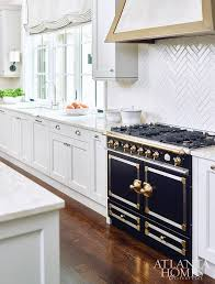 thin white herringbone kitchen backsplash tiles transitional