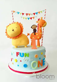 fun to be one cute birthday cake with bunting lion giraffe and