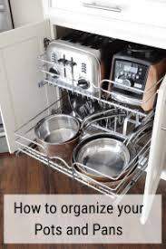 how to organize pots and pans in a cupboard how to organize pots and pans basilchic