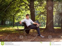 Model Bench Male Model Sitting On A Bench Stock Images Image 20966854