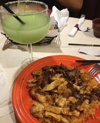jumbo margarita jumbo margarita plus shrimp chicken and steak rice enough said