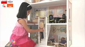 decorating amazing kidkraft dollhouse made of wood with pink roof