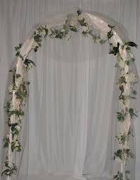 wedding arches using tulle wedding arch covered with tulle and accented with flowers
