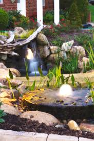landscaping project with koi pond u0026 stream