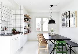 White Kitchen Tables by White Scandinavian Kitchen Design With Black Table Pendant Bench