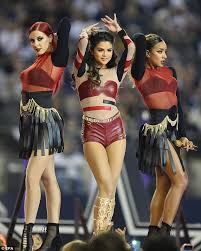 selena gomez is held high in the air by buff as she