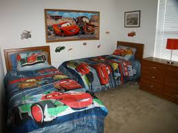 race car bed for toddlers great kids little tikes lightning minimaist car themed wooden twin bed with cars comforters also added brown wood varnish cabinets red bedroom