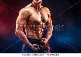 Chest And Shoulder - unrecognizable bald bodybuilder six pack stock photo