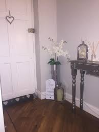 tall floor vase that u0027s been spayed chrome with orchid arrangement