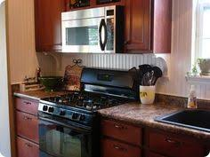 thrifty decor chick beadboard backsplash cozy kitchens notes from a maine interior designer inexpensive backsplashes to
